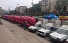 Киевскую мэрию атакуют розовые улитки