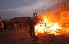 Во Франции беженцы подожгли свой лагерь