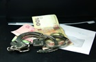 В Бердянске попавшийся на взятке чиновник таранил полицейских
