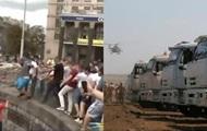 Столкновения на Майдане и российский гуманитарный конвой. Главные видео недели