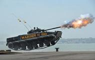 Парад морских танков, помидоры для нардепов, день рождения Путина: фото дня