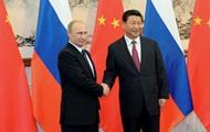 Путин подарил председателю Китая российский YotaPhone
