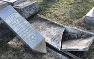 In the US, vandals desecrated the Jewish cemetery