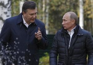 Янукович и Азаров поздравили Путина с победой