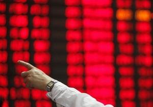 Азиатские рынки акций закрылись снижением из-за неприятия риска