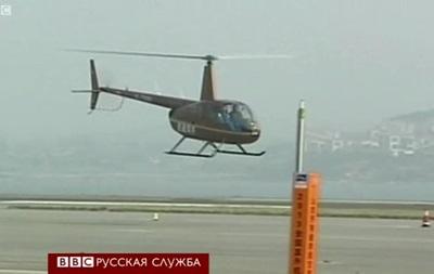 Китайский пилот открыл пиво вертолетом