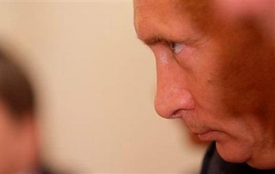 Путин по телефону поговорил с Асадом о химическом оружии