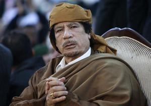 СМИ: На похоронах Каддафи присутствовали четыре человека
