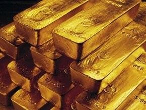 Рынок сырья: Золото выросло из-за падения на бирже