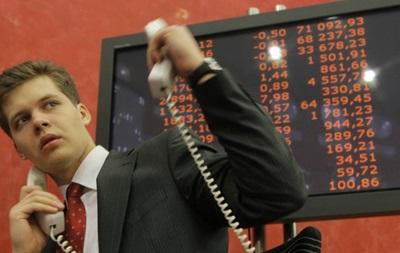 На ММВБ рубль ослабел на фоне спроса на доллар