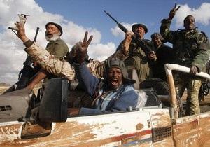 Human Rights Watch: Ливийские повстанцы ответственны за грабежи, поджоги и насилие