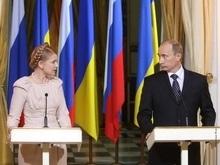 Путин пригласил Тимошенко в Москву на 2 октября