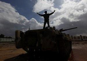 Премьер Турции призвал силы Каддафи заключить противников в объятия