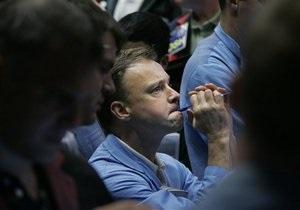 Обзор: Мировые фондовые индексы снизились, золото дешевеет