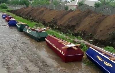 Стихийные захоронения в Славянске ведут к эпидемиям в области - ДонОГА