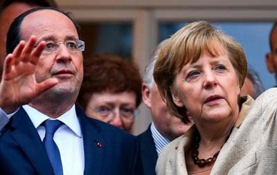 Меркель и Олланд призвали Путина содействовать диалогу в Украине