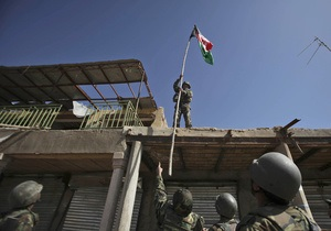 Промежуточная победа НАТО: На крыше центрального рынка Марджи водрузили афганский флаг