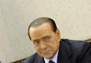 Берлускони предстанет перед судом по обвинению в коррупции