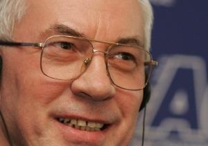Азаров и Литвин поздравили украинских женщин с 8 марта