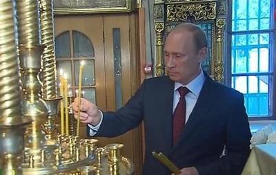Путин поставил свечи за  защитников Новороссии