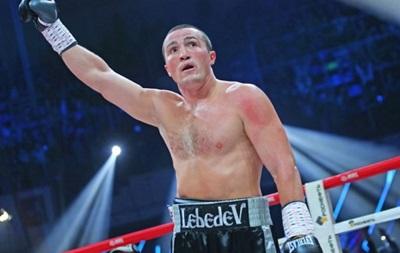 Российский боксер Денис Лебедев нокаутом отстоял чемпионский пояс