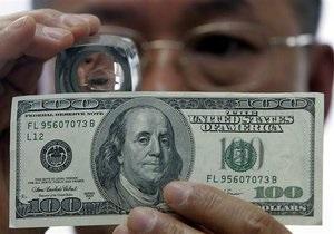 Доллар упал к иене до минимума за 15 лет