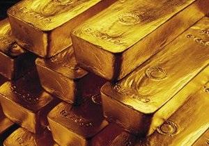 Мировые цены на золото упали до минимума трех недель