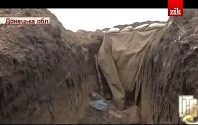 Украинские бойцы под Дебальцево спят в холодных копанках