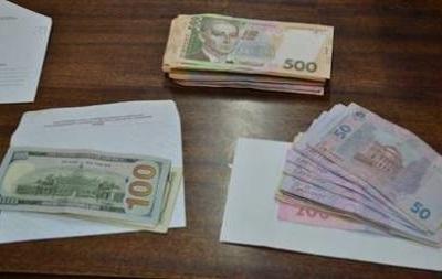 В Киеве два медика требовали у инвалида 50 тысяч грн взятки за справку