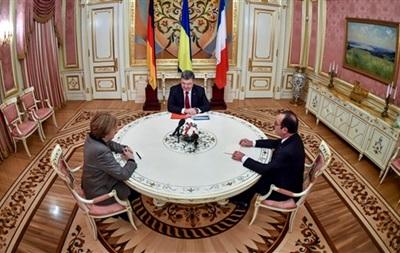 Порошенко, Олланд и Меркель обсудили пути реализации минских соглашений