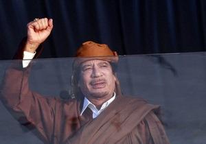 В Ливии разграбили и сожгли семейный дворец Каддафи