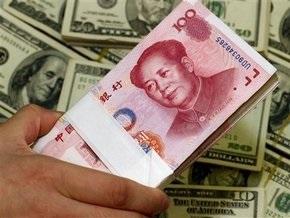 Юань продемонстрировал рекордное падение к доллару