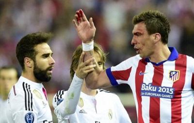 Форвард Атлетико заявил, что в матче с Реалом его никто не кусал