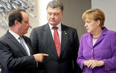 Порошенко обсудил с Меркель и Олландом выполнение минских договоренностей