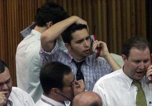 Рынки: Украинские фондовые торговцы массово выходят из рисковых бумаг