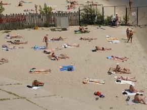 Водителя BMW, переехавшего загоравшую на пляже девушку, избили до потери сознания