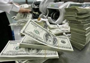 В феврале поддержка курса гривны обошлась Нацбанку более чем в $220 млн