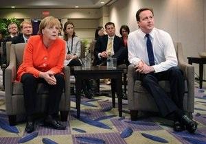 Меркель и Кэмерон ушли с заседания G-20 смотреть футбол