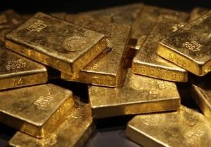 Мировые цены на золото снижаются из-за падения котировок евро