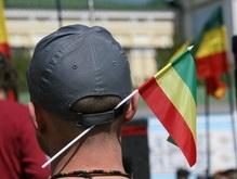 Марш Свободы в центре Киева отгородил Беркут и накрыл дождь