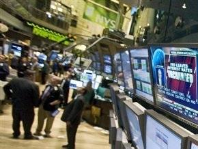 Рынки: Акции к середине дня снизились