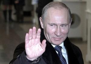 Путин вместе с супругой проголосовали на выборах президента РФ