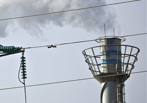 Австралия: премьер защищает налог на парниковые газы