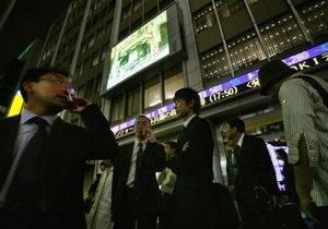 Китайские акции немного подорожали благодаря отчетам банков