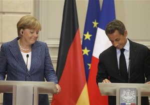 Испания и Италия приветствовали решения Меркель и Саркози, но хотят большего