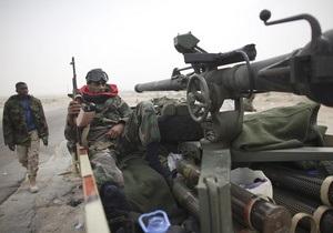 Ливийские повстанцы во второй раз отбили у войск Каддафи ключевой город
