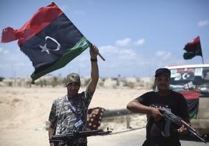 Нидерланды передадут ВОЗ деньги с замороженных счетов Каддафи