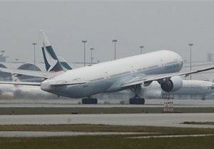 Гонконгский авиаперевозчик может отложить рекламную кампанию из-за скандальных фотографий из кабины пилота