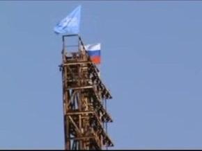 В Херсоне на вышке центрального стадиона водрузили флаги России и Партии регионов