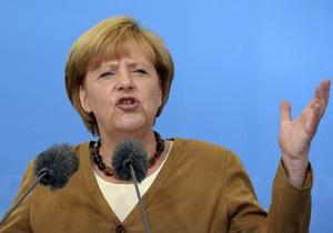 Меркель выступила против списания части долгов Греции